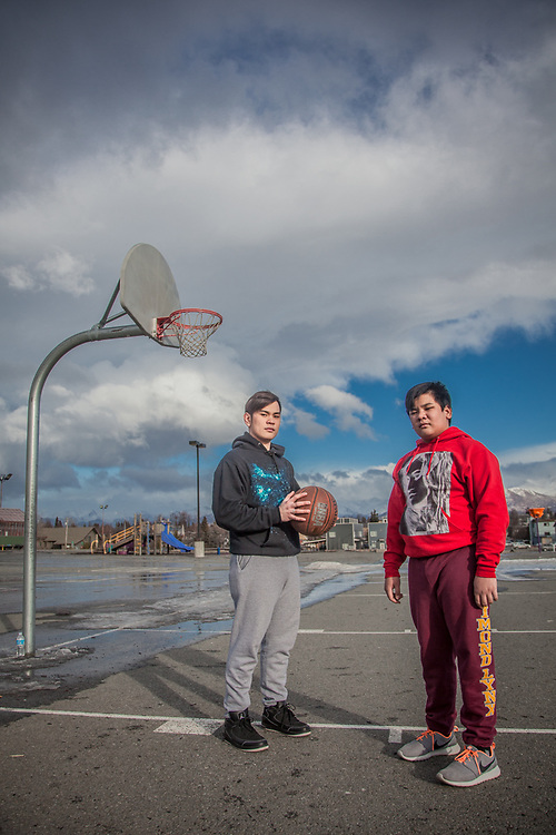 "Ron Bares and his brother Angelo play basketball on the first warm day in a week at Chugach Elementary School, Anchorage  ""I work at McDonalds but I hope to find a better job.""  -Ron Bares   bares_raphael@yahoo.com"