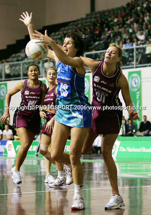 Sting Goal Shoot Tania Dalton takes a pass under pressure during the 2006 National Bank Cup round 4 netball game between the Force and the Sting held at North Shore Events Centre, Auckland, New Zealand on Sunday 21 May 2006. Photo: Tim Hales/PHOTOSPORT