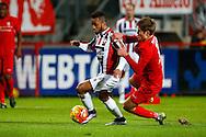 28-11-2015 VOETBAL:FC TWENTE-WILLEM II:ENSCHEDE<br /> Funso Ojo van Willem II in duel <br /> <br /> Foto: Geert van Erven