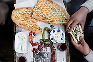 Pigeon fancier's breakfast in Sanliurfa, Turkey. Roasted peppers, white cheese, pide bread, tea.