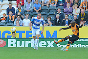 Sone Aluko  crosses the ball during the Sky Bet Championship match between Hull City and Queens Park Rangers at the KC Stadium, Kingston upon Hull, England on 19 September 2015. Photo by Ian Lyall.