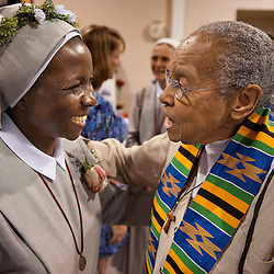 6 JULY 2013 -- CREVE COEUR, Mo. -- Sister Leonora Najjemba (left), SSPC, talks with Sister Mary Antona Ebo, FSM, at a reception following a special Eucharistic Celebration of the 150th Birthday of Blessed Mary Theresa Ledochówska, Foundress of the Missionary Sisters of St. Peter Claver at St. Louis Abbey Church in Creve Coeur, Mo. Saturday, July 6, 2013.  Sister Leonora renewed her religious vows during the celebration. Photo by Sid Hastings | for the St. Louis Review.