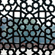 Morocco, castle, lattice, grille, wrought iron grille, geometric, abstract, pattern, outdoors, moroccan, window, closeup, close-up, close up, courtyard, outside, North Africa, shooting through, architecture, metalwork, metal work,