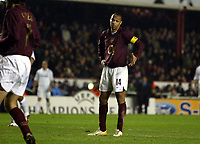 Photo: Chris Ratcliffe.<br /> Arsenal v Real Madrid. UEFA Champions League. 08/03/2006.<br /> Thierry Henry asks how easy can it be