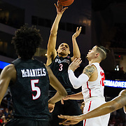 15 March 2018: San Diego State Aztecs guard Trey Kell (3) attempts a jump shot in the paint while being defended by Houston Cougars guard Rob Gray (32) in the first half. The San Diego State Aztecs got knocked out in the first round by Houston on a last second layup to lose 67-65  at Intrust Bank Arena in Wichita, Kansas.