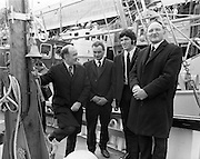 New Fishing Vessels at Dun Laoghaire..1971..26.03.1971..03.26.1971..26th March 1971..After display at the World Fishing Exhibition,three fishing vessels valued at £200,000 were handed over to their respective skippers at Dun Laoghaire harbour. The vessels were built by B.I.M.(Bord Iascaigh Mhara) and represent a cross section of the range of boats built in B.I.M. yards..Image of (L-R) Mr Brendan O'Kelly,Chairman,BIM, Skippers; Mr George Corr,Mr George Rogan, both of Skerries and Mr Jimmy Power, Kilmore Quay at the hand over of the new fishing vessels.