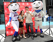 Mr. and Mrs. Met share ice cream with fans at the launch of the Good Humor Summer of Joy campaign, Tuesday, June 24, 2014, in New York City.  Good Humor Pedicabs will travel the streets of New York for the next six weeks to give out joy rides and other fun surprises.  (Diane Bondareff/Invision for Good Humor/AP Images)