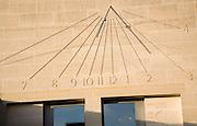 Modern sun dial clock Foundress Court sundial in Pembroke College, University of Cambridge, England