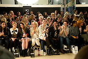 FRONT ROW INCLUDES; BLAKE WOOD; PEACHES GELDOF; ELIZABETH JAGGER; JAMIE WINSTONE; ALFIE ALLEN; PIXIE GELDOF; TOM GIDDINS, ' Colour Me Happy' House of Holland fashion show , Quaglinos. Bury St. London. 24 February 2009.