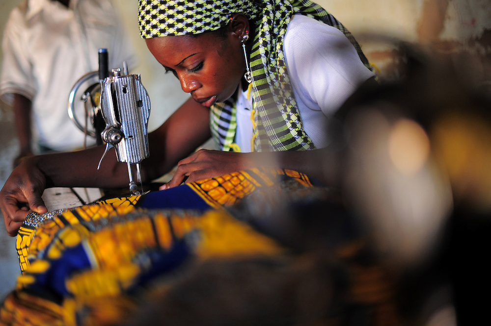 12-06-07   - TOGO -  Sofia Adama (Name changed) works in a tailor shop in Central Togo on June 7. Adama was branded as an outcast in her village in central Togo after a botched injection left her crippled as an infant. Through Plan Togo, she was able to walk and get vocational training. The rights and needs of children with disabilities in Togo has been recognized as an important social issue. Photo by Daniel Hayduk