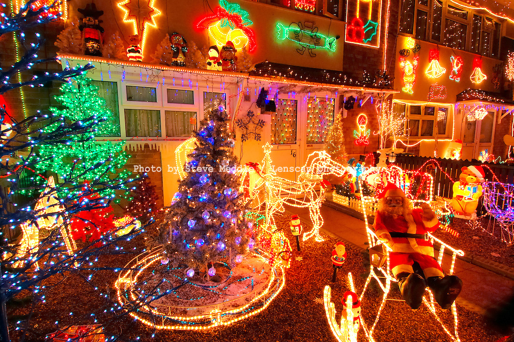 Row of Council Houses with Illuminated Christmas Decorations