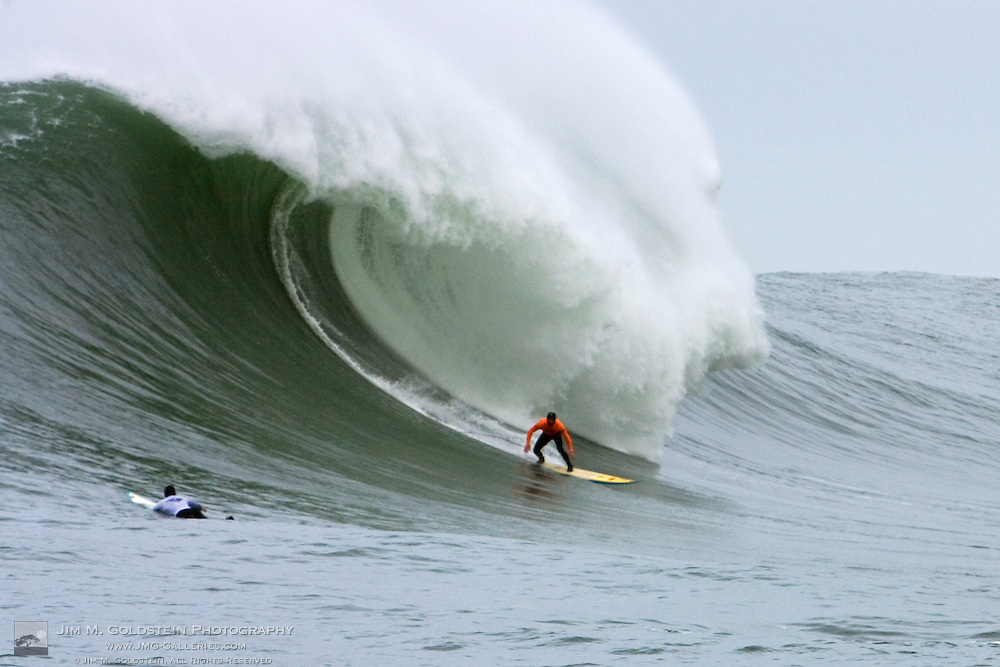 Shawn Rhodes surfs a gigantic wave during Heat 1 at the 2008 Mavericks Surf Contest on January 12 2008