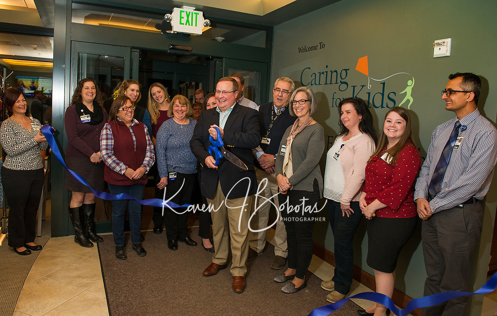 The ribbon cutting ceremony with LRGH President Kevin Donovan having the honor during the open house for LRGHealthcare Mothers' Milk Dispensary in Belmont Wednesday evening.  (Karen Bobotas/for the Laconia Daily Sun)