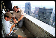 Brian Crawford and father Walt band wild peregrine falcon chick, Missouri's first in over 100 years, atop ATT building; St. Louis, Missouri