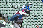 Umbrellas are up as rain stops play during the Specsavers County Champ Div 1 match between Somerset County Cricket Club and Essex County Cricket Club at the Cooper Associates County Ground, Taunton, United Kingdom on 26 September 2019.