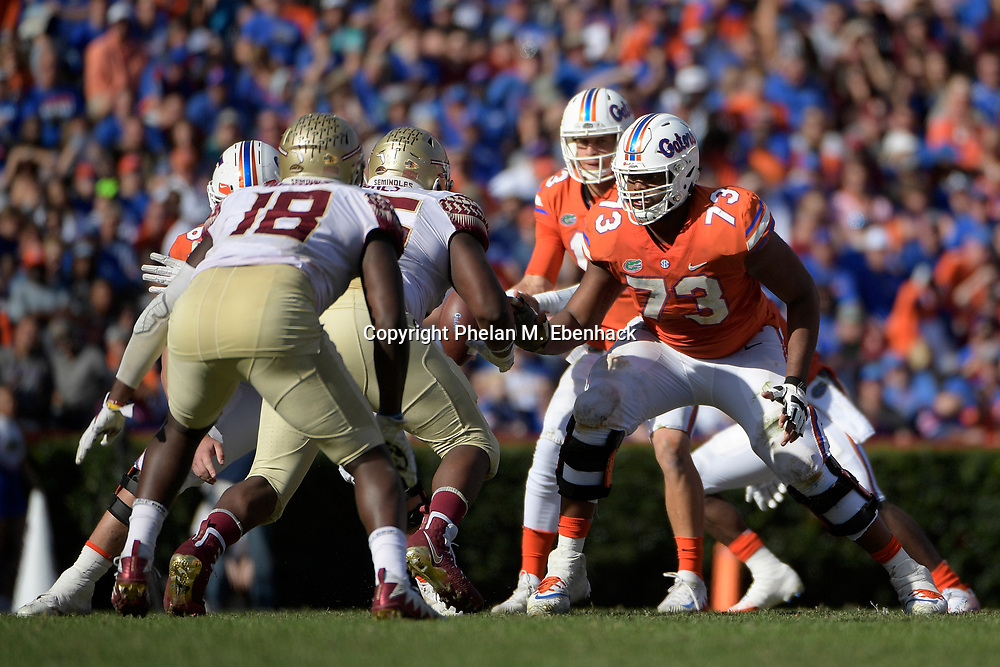 Florida offensive lineman Martez Ivey (73) sets up to block during the second half of an NCAA college football game against Florida State Saturday, Nov. 25, 2017, in Gainesville, Fla. FSU won 38-22. (Photo by Phelan M. Ebenhack)