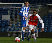 Arsenal midfielder Jeff Reine-Adelaide shields the ball from Brighton defender Ben Barclay during the Barclays U21 Premier League match between Brighton U21 and Arsenal U21 at the American Express Community Stadium, Brighton and Hove, England on 30 November 2015. Photo by Bennett Dean.