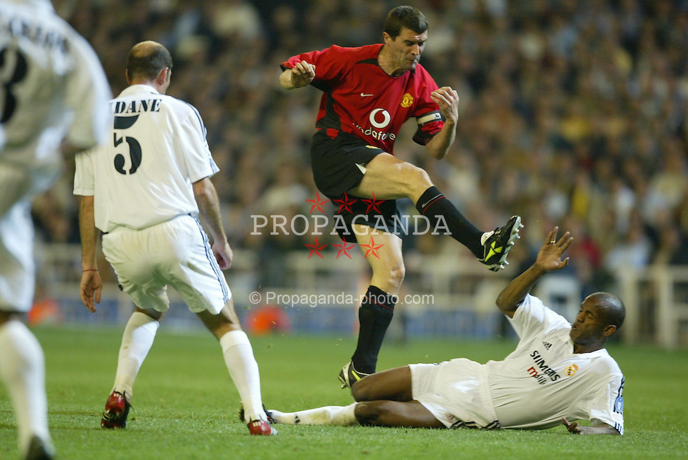 MADRID, SPAIN - Tuesday, April 8, 2003: Manchester United's Roy Keane sees his shot blocked by Real Madrid's Flavio Conceicao during the UEFA Champions League Quarter Final 1st Leg match at the Estadio Santiago Bernabeu. (Pic by David Rawcliffe/Propaganda)