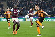 Hull City defender Max Clark (24) and Aston Villa defender Axel Tuanzebe (28) battles for possession  during the EFL Sky Bet Championship match between Hull City and Aston Villa at the KCOM Stadium, Kingston upon Hull, England on 31 March 2018. Picture by Mick Atkins.