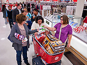 "25 NOVEMBER 2011 - PHOENIX, AZ:  L to R: Kelly Lloyd (CQ), from Phoenix, Oat Craig (CQ) from Maricopa and her daughter Samanth Craig (CQ) also from Maricopa, wait in line to check out in the Target Store across the street from Paradise Valley Mall Friday morning. ""Black Friday,"" the unofficial start of the holiday shopping season started even earlier than normal. Many stores, including Target and Best Buy, opened at midnight.    Photo by Jack Kurtz"
