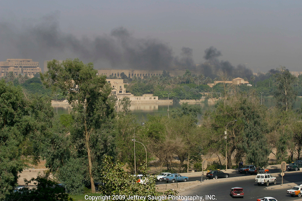 Black smoke rises over the Tigris River visible from the 16-story Palestine Hotel in Baghdad, Iraq, that was home to hundreds of foreign journalists, including many who stayed here during the war.
