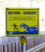 Water rising warning sign due to opening of dam gates In German, English and Italian. Photographed in Gerlos, Zillertal, Tirol, Austria