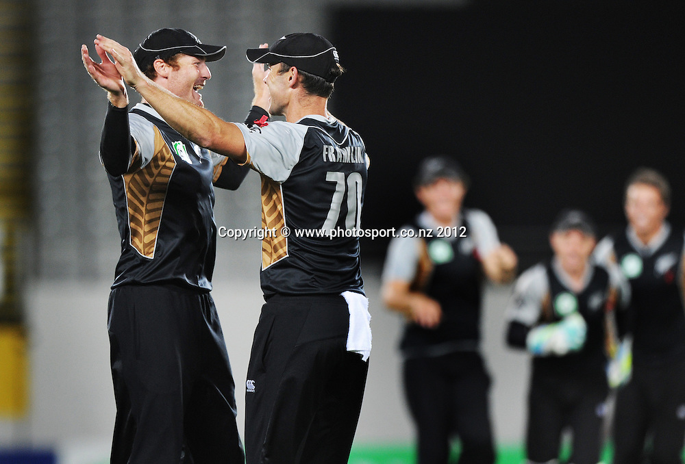 Martin Guptill celebrates with James Franklin after taking a catch to dismiss Johan Botha during the 3rd and final InternationaI Twenty20 cricket match between New Zealand Black Caps and South Africa at Seddon Park, Hamilton, New Zealand on Wednesday 22 February 2012. Photo: Andrew Cornaga/Photosport.co.nz