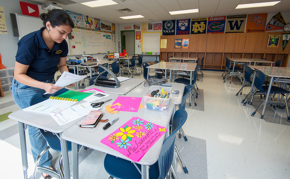 Morgan Giannotti prepares her 7th grade history classroom for the first day of school at the Rusk School, August 22, 2014.
