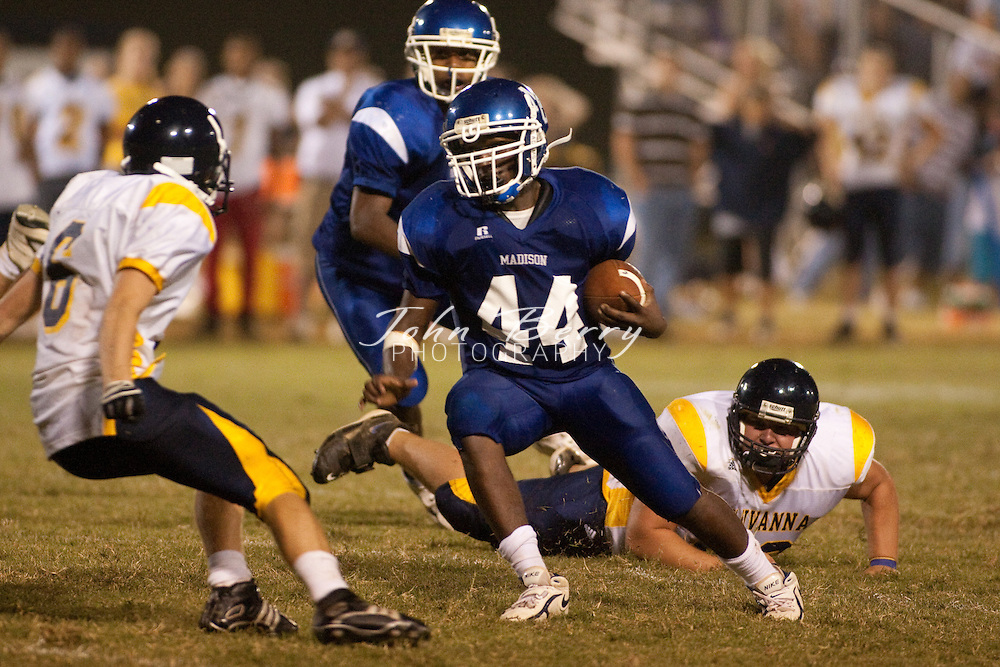 MCHS Varsity Football vs Fluvanna Flucos, 9/4/09, The Varsity Football team won their season opener tonight 26-20 in 3 overtimes against Fluvanna. Stephen Dixon kicked a 27 yard field goal with 1 minute left in regulation to tie the score at 6-6. It was Dixon's second field goal of the night. The overtime was a thrill ride as Fluvanna scored on a 4th and 22 to take a 13-6 lead. Madison's Logan Terrell  scored from a yard out and Dixon tied the game at 13 with the extra point. Fluvanna would score in the 2nd overtime, this time on a 4th and 13 play. Madison tied the game again with a bruising 7 yard run from Jerod Williams. The Mountaineer defense held the Flucos in the 3rd overtime and Terrell scored from 4 yards out to seal the win. Madison is now 1-0 on the season