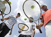Colombian Tennis former champion, Miguel Tobon, right, plays with a racket and ball next to his students at Pembroke Lakes Tennis Club on Tuesday June 16, 2009.  Staff photo/Cristobal Herrera....