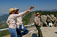 Ranger led natural history education talk given to tourist hikers on top of Moro Rock, Sequoia National Park, California
