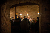 Vilnius, Lithuania- June 4, 2015: Patrons dining at Forto Dvaras, a traditional Lithuanian restaurant known for it's rich rustic fare. The restaurant features subterranean dining rooms that represent different regions of the country and feature elaborate frescoes that allude to the countries pagan roots. CREDIT: Chris Carmichael for The New York Times