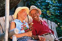 Couple Enjoying Porch Swing --- Image by © Jim Cummins/CORBIS