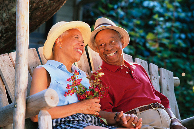 Couple Enjoying Porch Swing --- Image by © Jim Cummins/CORBIS