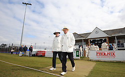 The umpires enter the field for the first time - Photo mandatory by-line: Harry Trump/JMP - Mobile: 07966 386802 - 23/03/15 - SPORT - CRICKET - Pre Season Fixture - Day 1 - Somerset v Glamorgan - Taunton Vale Cricket Club, Somerset, England.