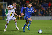 AFC Wimbledon midfielder Scott Wagstaff (7) dribbling away from Burton Albion midfielder Jamie Murphy (29) during the EFL Sky Bet League 1 match between AFC Wimbledon and Burton Albion at the Cherry Red Records Stadium, Kingston, England on 28 January 2020.