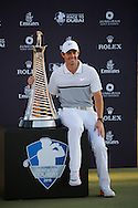 Rory McIlroy celebrates winning The Race To Dubai Tournaments with the trophy on the 4th