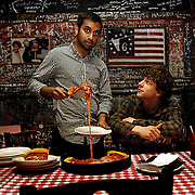 "Aziz Ansari and Jesse Eisenberg serve up pizza at Gino's East in Chicago while promoting their new movie ""30 Minutes or Less"" on Thursday, July 7, 2011."