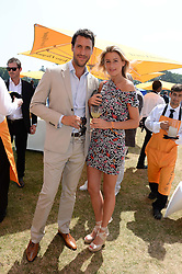 TOBY GILBERT and FENELLA TAGGART at the Veuve Clicquot Gold Cup, Cowdray Park, Midhurst, West Sussex on 21st July 2013.