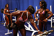 Women's Physique International contestants warm up in the pump up room backstage at the Greater Columbus Convention Center during the Arnold Sports Festival 2017 on March 3, 2017 in Columbus, Ohio.