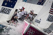 ENGLAND, Weymouth. 30th July 2012. Olympic Games. Elliott 6m. Womens Match Racing. Team USA vs Tean AUS. Anna Tunnicliffe, Deborah Capozzi, Molly O'Bryan Vandemoer (USA) Crew