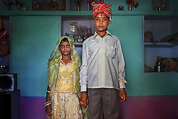 Maya, 8, and Kishore, 13, pose for a wedding photo inside their new home, the day after the Hindu holy day of Akshaya Tritiya, called Akha Teej in North India. Despite legislation forbidding child marriage in India (Child Marriage Restraint Act-1929) and the much more progressive Prohibition of Child Marriage Act (2006) and many initiatives to prevent child marriage, marrying children off at a very tender age continues to be accepted by large sections of society.