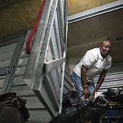 WASHINGTON, DC-OCT14: Felnibe Patefagou, 32, from Togo, in his storage unit at Capital Self-Storage, October 14,  2015. Many of the area homeless have possessions they want to keep safe, just nowhere permanent to live, so they store their belongings at Capital Self-Storage, where an upper-level unit costs $30/month. Some of the homeless patrons also spend their days in their storage units, when shelters are closed during midday hours. The storage facility near 3rd and Florida Avenue in Northeast, Washington, DC, is about to be replaced by a boutique hotel. (Photo by Evelyn Hockstein/For The Washington Post)