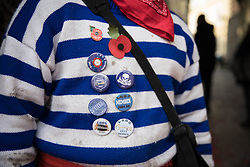 © Licensed to London News Pictures. 05/11/2016. Lewes, UK. A reveller, dressed in the stripes of his borough, await the start of the annual bonfire night parade in Lewes, East Sussex. The celebrations, which mark the Guy Fawkes 1605 Gunpowder Plot to blow up Parliament, date back to the 1850s. Photo credit: Rob Pinney/LNP