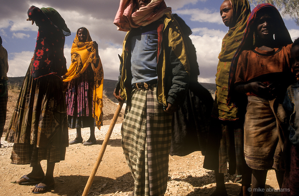 People wearing traditional clothes on the road to  Harar, Ethiopia