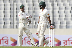 August 28, 2017 - Mirpur, Bangladesh - Bangladesh's Tamim Iqbal And Australia's Matthew Wade are talking to eact other  during day two of the First Test match between Bangladesh and Australia at Shere Bangla National Stadium on August 28, 2017 in Mirpur, Bangladesh. (Credit Image: © Ahmed Salahuddin/NurPhoto via ZUMA Press)