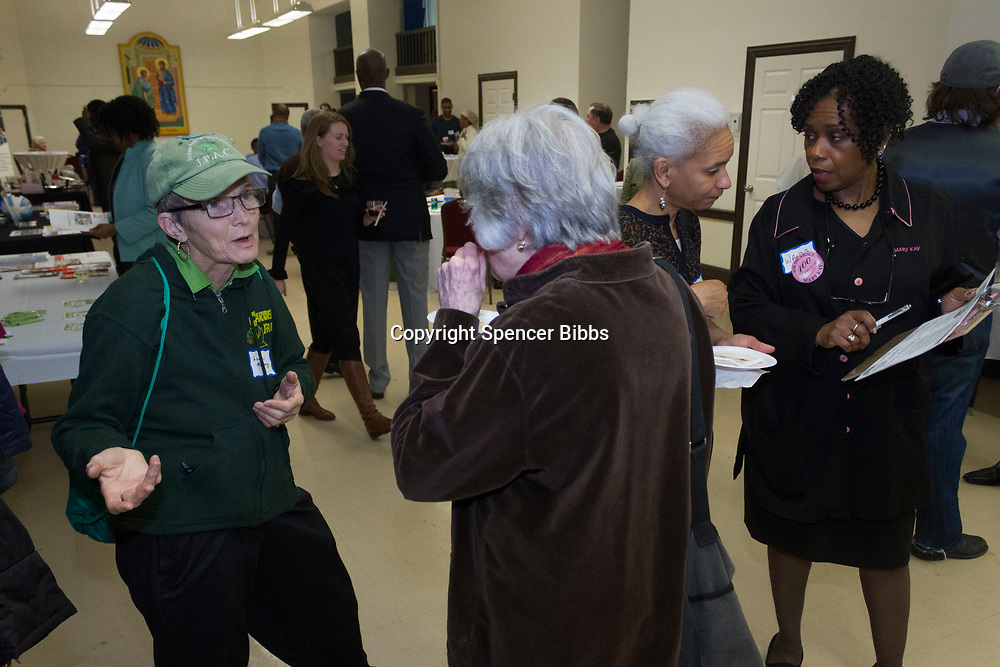 "The Hyde Park Chamber of Commerce held its monthly Chamber Check-In networking event Thursday evening, March 1, 2018 at Saint Thomas the Apostle Church located at 5467 S. Woodlawn. This monthly event hosted by the chamber is held every first Thursday of the month and gives businesses and community members the chance to network and socialize.<br /> <br /> 5503 – President of the Jackson Park Advisory Council, Louise McCurry and others network during the event.<br /> <br /> Please 'Like' ""Spencer Bibbs Photography"" on Facebook.<br /> <br /> Please leave a review for Spencer Bibbs Photography on Yelp.<br /> <br /> Please check me out on Twitter under Spencer Bibbs Photography.<br /> <br /> All rights to this photo are owned by Spencer Bibbs of Spencer Bibbs Photography and may only be used in any way shape or form, whole or in part with written permission by the owner of the photo, Spencer Bibbs.<br /> <br /> For all of your photography needs, please contact Spencer Bibbs at 773-895-4744. I can also be reached in the following ways:<br /> <br /> Website – www.spbdigitalconcepts.photoshelter.com<br /> <br /> Text - Text ""Spencer Bibbs"" to 72727<br /> <br /> Email – spencerbibbsphotography@yahoo.com"