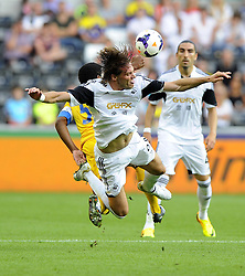 "Swansea City's Michu battles for the high ball with Petrolul Ploiesti captain, Sony Mustivar  - Photo mandatory by-line: Joe Meredith/JMP - Tel: Mobile: 07966 386802 22/08/2013 - SPORT - FOOTBALL - Liberty Stadium - Swansea -  Swansea City V Petrolul Ploiesti - Europa League Play-Off EDITORIAL USE ONLY. No use with unauthorised audio, video, data, fixture lists, club/league logos or ""live"" services. Online in-match use limited to 45 images, no video emulation. No use in betting, games or single club/league/player publications"