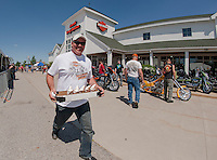 Andre Chenier of Apple Hill Canada keeps a brisk pace for ice cream delivery to his buddies at the Laconia Harley Davidson's vendor complex on Thursday afternoon.  (Karen Bobotas/for the Laconia Daily Sun)