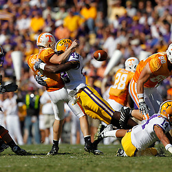 Oct 2, 2010; Baton Rouge, LA, USA; LSU Tigers defensive end Barkevious Mingo (49) sacks and forces a fumble by Tennessee Volunteers quarterback Matt Simms (2) during the first half at Tiger Stadium.  Mandatory Credit: Derick E. Hingle
